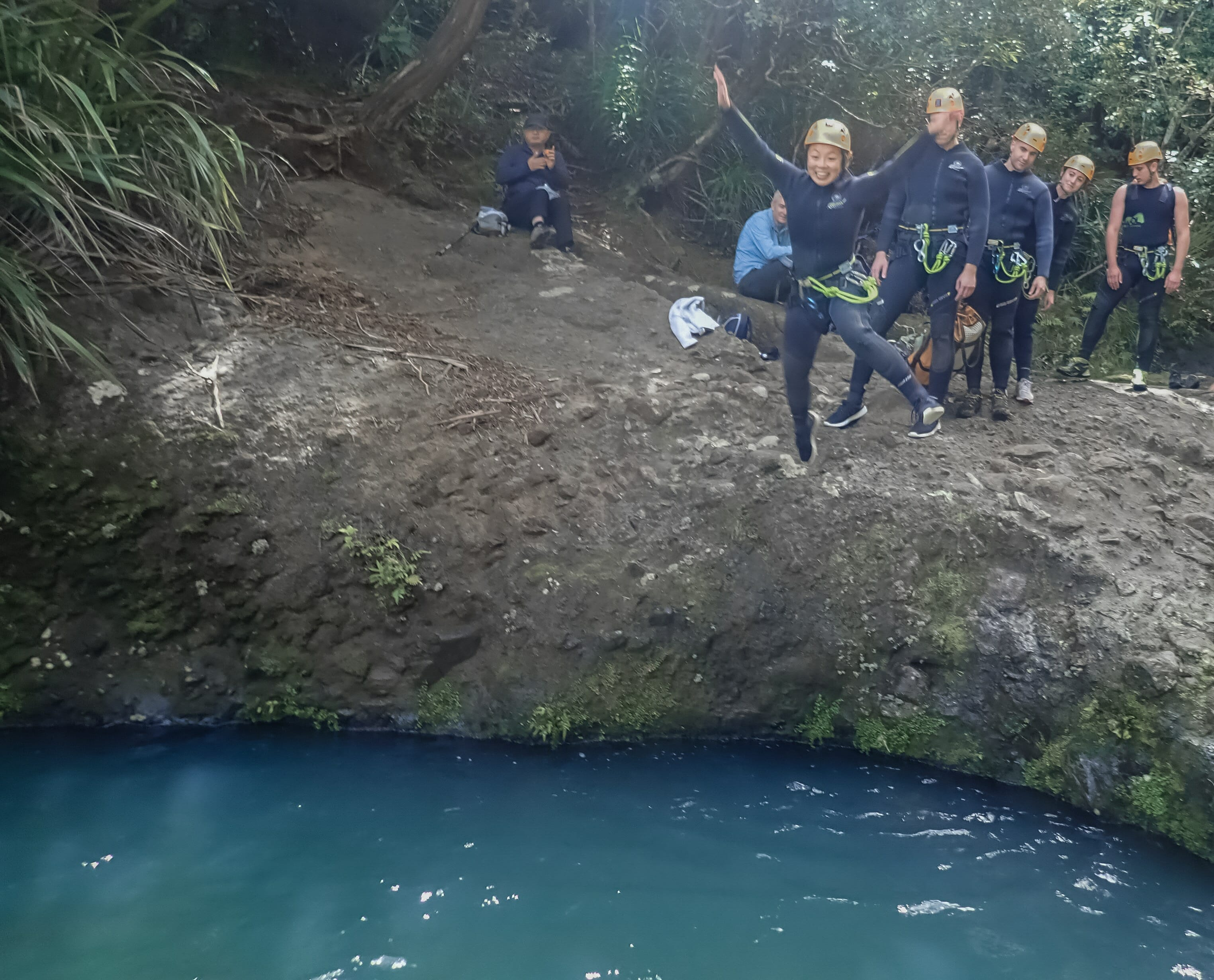 Cliff jumping at Piha Canyon