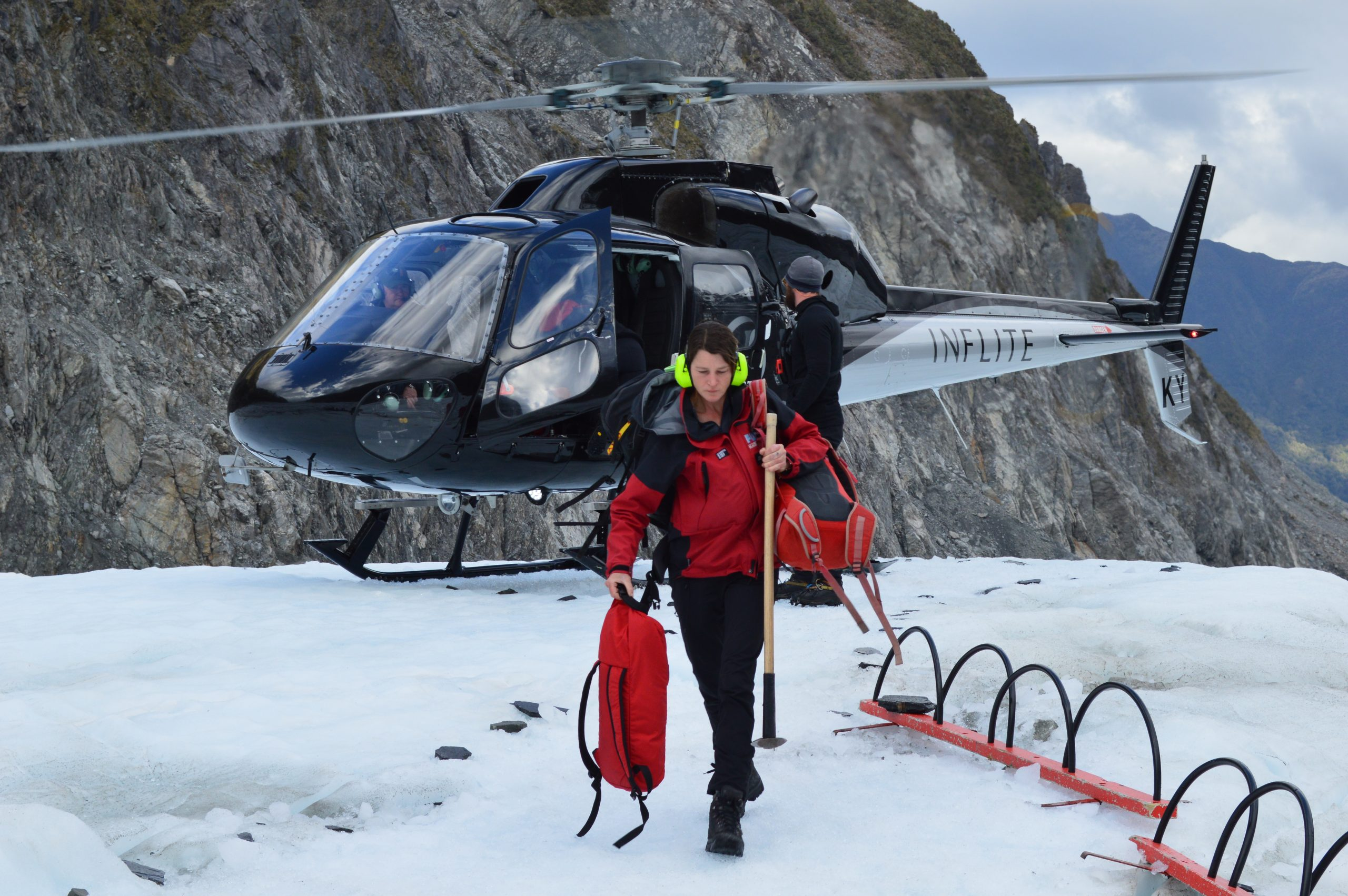 Disembarking from the helicopter onto the glacier