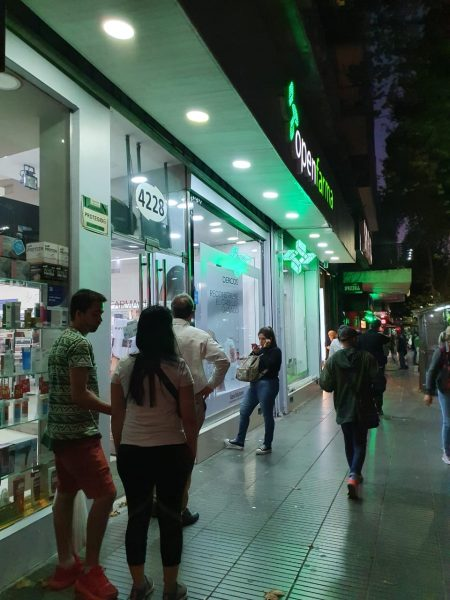 People waiting outside a pharmacy in Buenos Aires